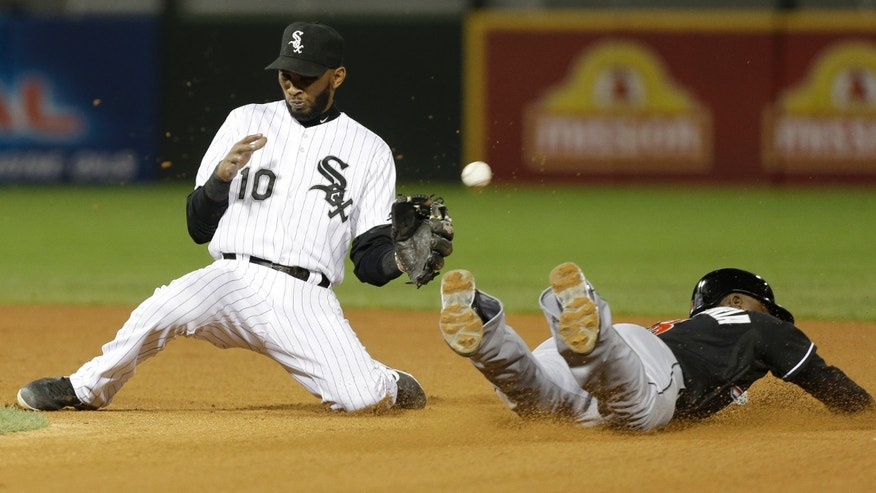 Miami Marlins' Adeiny Hechavarria, right, steals second as Chicago White Sox shortstop Alexei Ramirez cannot make a catch during the eighth inning of a baseball game on Friday, May 24, 2013, in Chicago. (AP Photo/Nam Y. Huh)