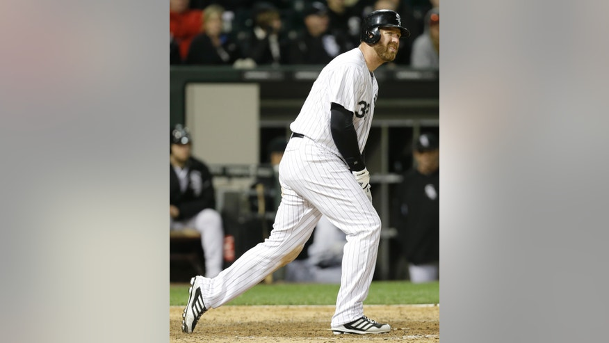 Chicago White Sox's Adam Dunn reacts after striking out swinging during the eighth inning of a baseball game against the Miami Marlins, Friday, May 24, 2013, in Chicago. AP Photo/Nam Y. Huh)