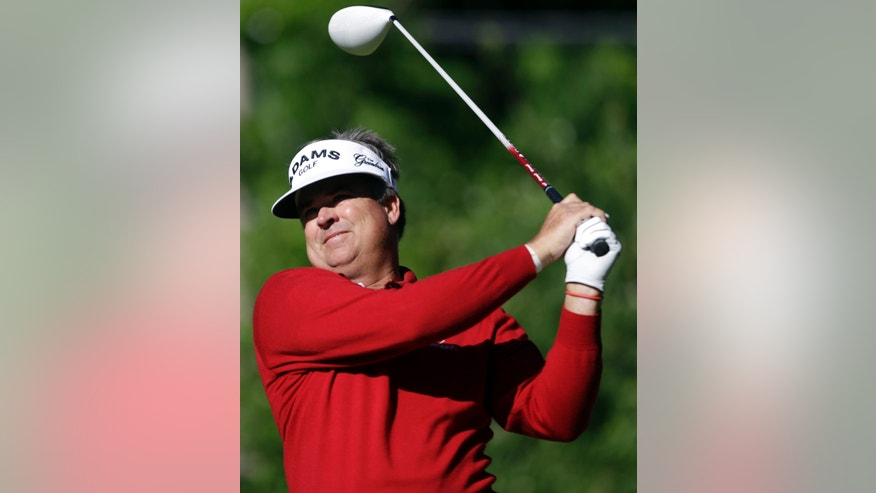 Kenny Perry tees off on the ninth hole during the second round of the 74th Senior PGA Championship golf tournament at Bellerive Country Club Friday, May 24, 2013, in St. Louis. (AP Photo/Jeff Roberson)
