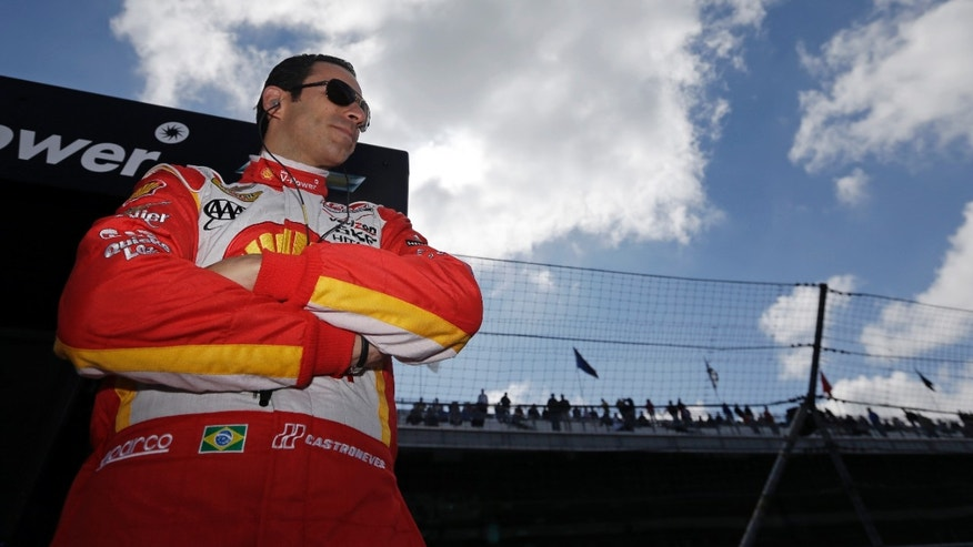 IndyCar driver Helio Castroneves, of Brazil, stands in his team pit box as he waits for the start of the final practice session for the Indianapolis 500 auto race at the Indianapolis Motor Speedway in Indianapolis, Friday, May 24, 2013. (AP Photo/Darron Cummings)