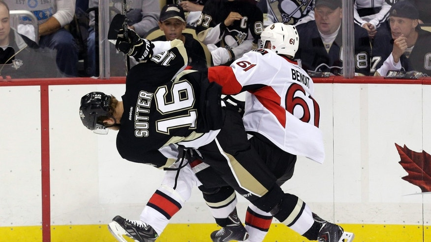 Pittsburgh Penguins' Brandon Sutter (16) collides with Ottawa Senators' Andre Benoit (61) during the first period in Game 5 of the Eastern Conference semifinals in their NHL hockey Stanley Cup playoffs series, Friday, May 24, 2013, in Pittsburgh. (AP Photo/Gene J. Puskar)