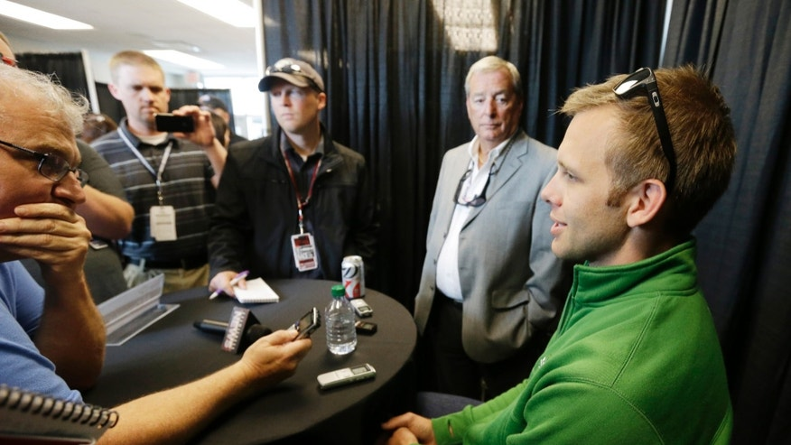Ed Carpenter, right, responds to a question during a media interview for the Indianapolis 500 auto race at the Indianapolis Motor Speedway in Indianapolis, Thursday, May 23, 2013. (AP Photo/Darron Cummings)