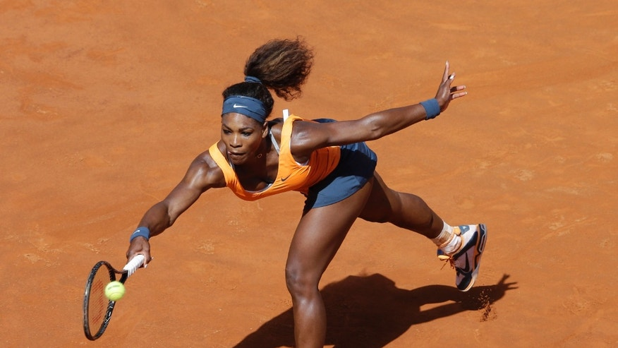 Serena Williams of the United States returns the ball to Belarus' Victoria Azarenka during their final match at the Italian Open tennis tournament in Rome, Sunday, May 19, 2013. Williams won 6-1, 6-3. (AP Photo/Alessandra Tarantino)
