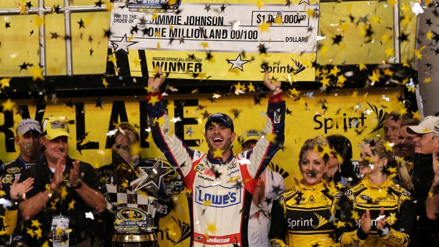 Jimmie Johnson celebrates in victory lane after winning the NASCAR All-Star auto race at Charlotte Motor Speedway in Concord, N.C., Saturday, May 18, 2013. (AP Photo/Chuck Burton)