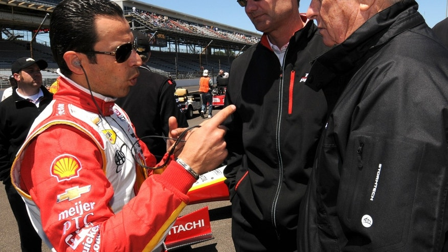 Driver Helio Castroneves, left, talks to Team Penske president Tim Cindric, and Roger Penske during the Pit Stop Contest on Carb Day at the Indianapolis Motor Speedway, Friday, May 24, 2013, in Indianapolis. (AP Photo/The Indianapolis Star, Kristin Enzor) NO SALES.