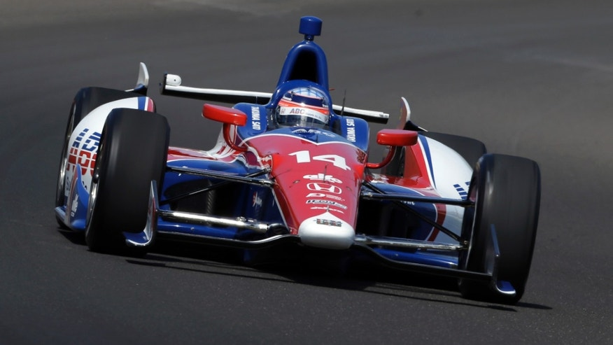 Takuma Sato, of Japan, drives through the first turn during the final practice session for the Indianapolis 500 auto race at the Indianapolis Motor Speedway in Indianapolis, Friday, May 24, 2013. (AP Photo/Tom Strattman)