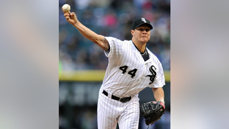 Chicago White Sox starter Jake Peavy delivers a pitch during the first inning of an interleague baseball game against the Miami Marlins in Chicago, Saturday, May 25, 2013. (AP Photo/Paul Beaty)