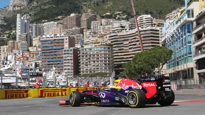 Red Bull driver Sebastian Vettel, of Germany, steers his car during the first free practice session at the Monaco racetrack, in Monaco, Thursday, May 23, 2013. The formula one race will be held on Sunday. (AP Photo/Antonio Calanni)