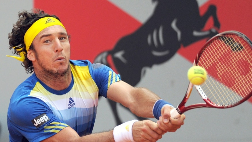 Argentina's  Juan Monaco  returns a ball during his semifinal match against compatriot Guido Pella at the Power Horse ATP tennis tournament in Duesseldorf, Germany, Friday May 24, 2013.  (AP Photo/dpa,Caroline Seidel)
