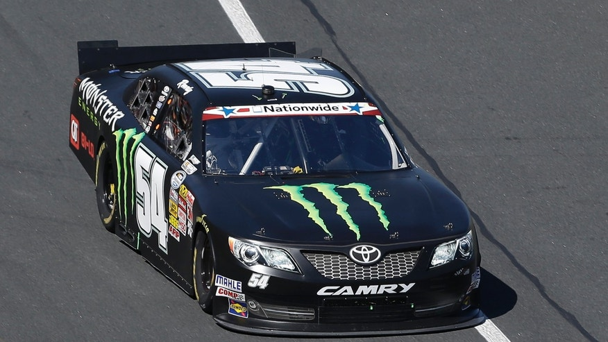 Kyle Busch (54) drives along the front stretch during the NASCAR Nationwide Series auto race at the Charlotte Motor Speedway in Concord, N.C., Saturday, May 25, 2013. (AP Photo/Gerry Broome)