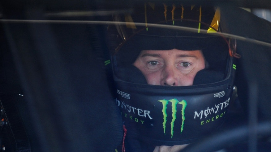 Kyle Busch waits in his car before practice for Sunday's NASCAR Sprint Cup series Coca-Cola 600 auto race at Charlotte Motor Speedway in Concord, N.C., Saturday, May 25, 2013. (AP Photo/Mike McCarn)