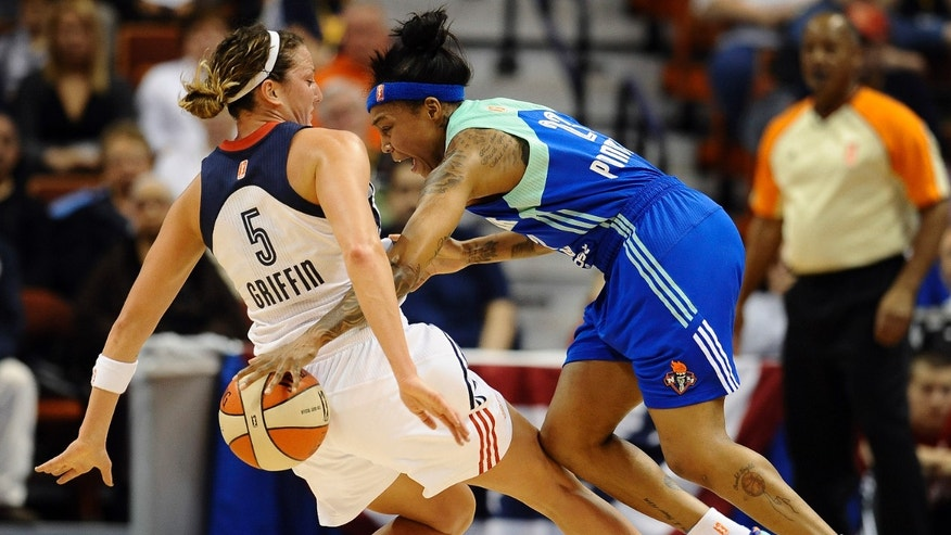 Connecticut Sun's Kelsey Griffin, left, fouls New York Liberty's Cappie Pondexter, right, during the first half of their WNBA basketball game in Uncasville, Conn., Saturday, May 25, 2013. (AP Photo/Jessica Hill)