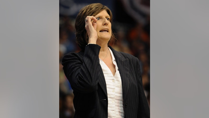 Connecticut Sun head coach Anne Donovan gestures during the first half of their WNBA basketball game against the New York Liberty in Uncasville, Conn., Saturday, May 25, 2013. (AP Photo/Jessica Hill)