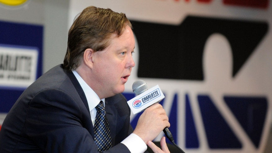NASCAR CEO Brian France answers a question during practice for Sunday's NASCAR Sprint Cup series Coca-Cola 600 auto race at Charlotte Motor Speedway in Concord, N.C., Saturday, May 25, 2013. (AP Photo/Mike McCarn)