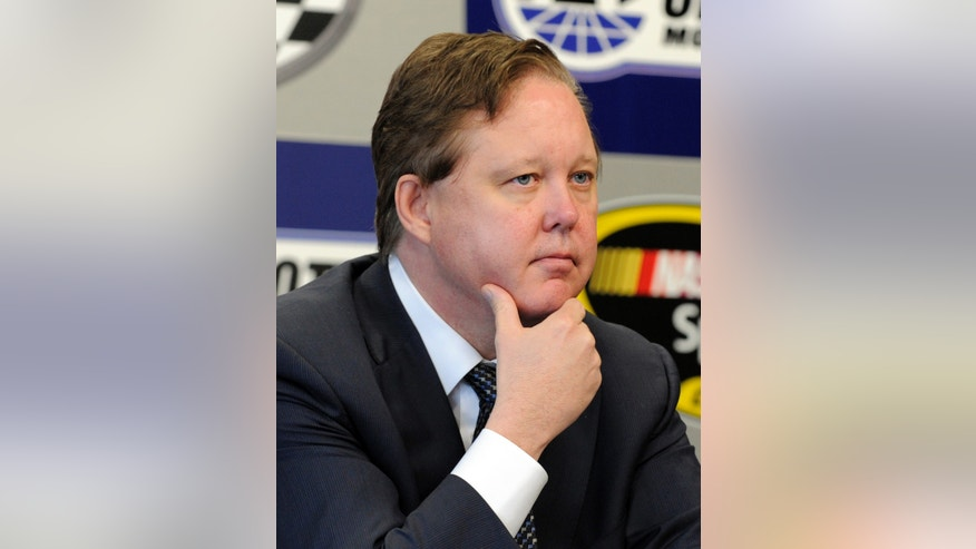 NASCAR CEO Brian France listens to a question during practice for Sunday's NASCAR Sprint Cup series Coca-Cola 600 auto race at Charlotte Motor Speedway in Concord, N.C., Saturday, May 25, 2013. (AP Photo/Mike McCarn)