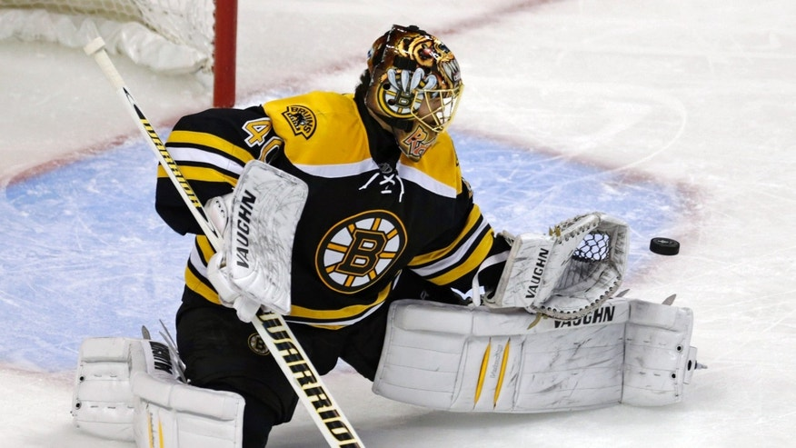 Boston Bruins goalie Tuukka Rask makes a save against the New York Rangers during the first period in Game 5 of the Eastern Conference semifinals in the NHL hockey Stanley Cup playoffs, Saturday, May 25, 2013, in Boston. (AP Photo/Charles Krupa)