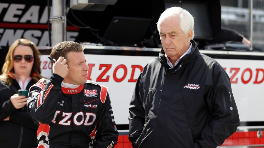 IndyCar team owner Roger Penske, right, talks with driver AJ Allmendinger before the start of the final practice session for the Indianapolis 500 auto race at the Indianapolis Motor Speedway in Indianapolis, Friday, May 24, 2013. (AP Photo/Darron Cummings)