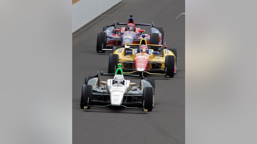Ed Carpenter, front, leads Carlos Munoz, of Colombia, center, and Marco Andretti into the first turn in the opening laps of the Indianapolis 500 auto race at the Indianapolis Motor Speedway in Indianapolis Sunday, May 26, 2013. (AP Photo/AJ Mast)