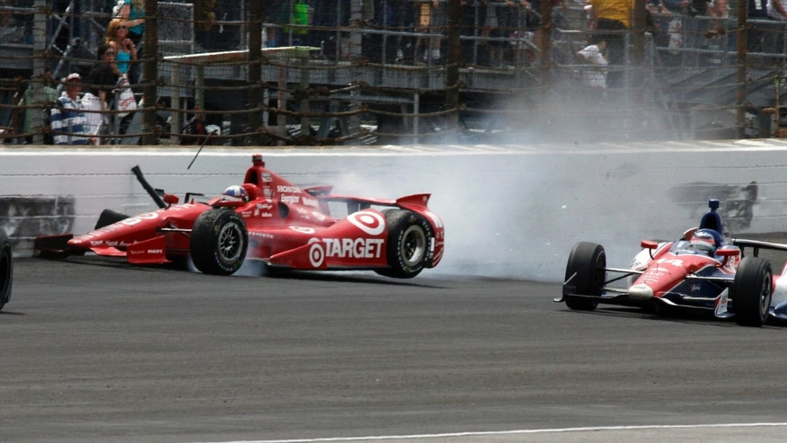 Dario Franchitti, left, of Scotland, hits the wall on the first turn in front of Takuma Sato, of Japan, to bring out the final caution during Indianapolis 500 auto race at Indianapolis Motor Speedway in Indianapolis, Sunday, May 26, 2013. (AP Photo/Tom Hemmer)