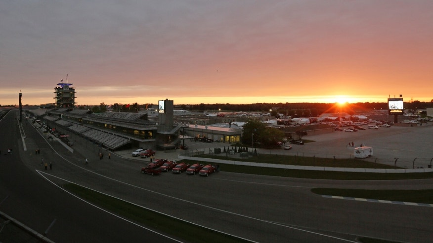 The sun rises over the grounds of the Indianapolis Motor Speedway in Indianapolis, Sunday, May 26, 2013. The 97th Indianapolis 500 starts at noon. (AP Photo/AJ Mast)