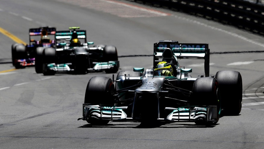 Mercedes driver Nico Rosberg of Germany leads his teammate Mercedes driver Lewis Hamilton of Britain and Red Bull driver Sebastian Vettel of Germany, during the Formula One Grand Prix at the Monaco racetrack, in Monaco, Sunday, May 26, 2013. (AP Photo/Luca Bruno)