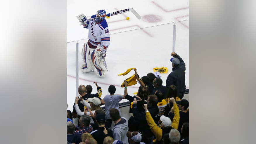 As Boston Bruins fans celebrate as New York Rangers goalie Henrik Lundqvist, of Sweden, skates down ice after losing 3-1 to the Boston Bruins, eliminating the Rangers from the NHL playoffs, in Game 5 of the Eastern Conference semifinals in the NHL hockey Stanley Cup playoffs in Boston, Saturday, May 25, 2013. (AP Photo/Charles Krupa)