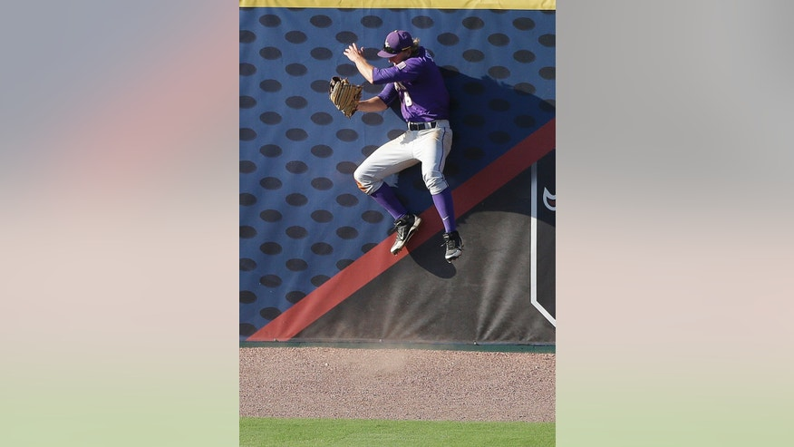 LSU center fielder Andrew Stevenson makes a catch to take away a base hit from Vanderbilt's Vince Conde with the bases loaded in the fifth inning of the Southeastern Conference Tournament championship baseball game at the Hoover Met in Hoover, Ala., Sunday, May 26, 2013. (AP Photo/Dave Martin)