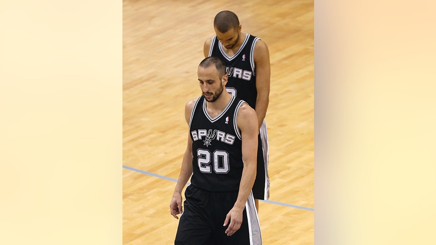San Antonio Spurs guard Manu Ginobili (20), of Argentina,  and Tony Parker, of France, walk the court during the first half in Game 3 of the Western Conference finals NBA basketball playoff series against the Memphis Grizzlies, Saturday, May 25, 2013, in Memphis. (AP Photo/Rogelio V. Solis)
