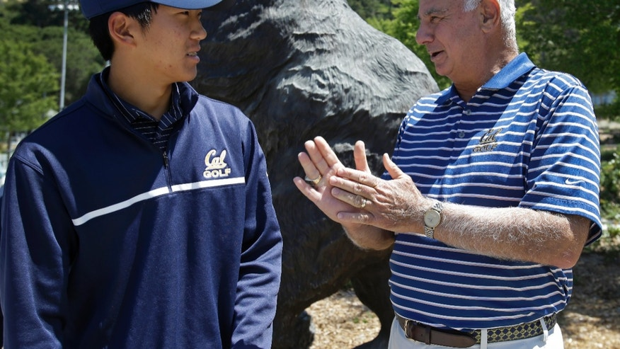 University of California's Michael Kim, left, speaks with golf coach Steve Desimone Thursday, May 23, 2013, in Berkeley, Calif. Cal has broken the modern-era NCAA single-season win record with 11 victories in its first 13 tournaments in 2012-13 and will conclude its season at the NCAA Championship hosted by Georgia Tech May 28 – June 2 in the Atlanta area at the Capital City Club's Crabapple Course in Milton, Ga. (AP Photo/Ben Margot)