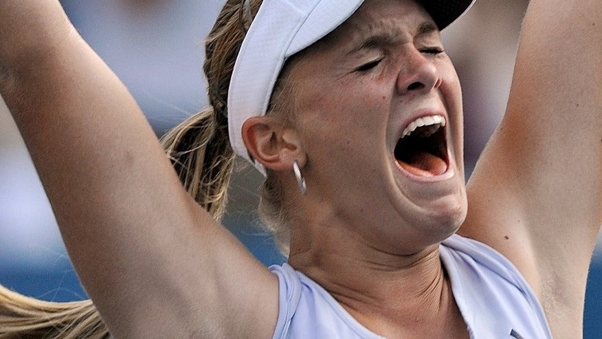 FILE - In this Saturday, Sept. 5, 2009 file photo, Melanie Oudin, of the United States, celebrates her upset 3-6, 6-4, 7-5 victory over Maria Sharapova, of Russia, during the third round of the U.S. Open tennis tournament in New York. Oudin won her first-round match at the French Open on Monday, May 27, 2013, upsetting 28th-seeded Tamira Paszek, of Austria 6-4, 6-3. Oudin says she feels free now of the pressure and expectations that hampered her career after she reached the 2009 U.S. Open quarterfinals at age 17. (AP Photo/Paul J. Bereswill, File)