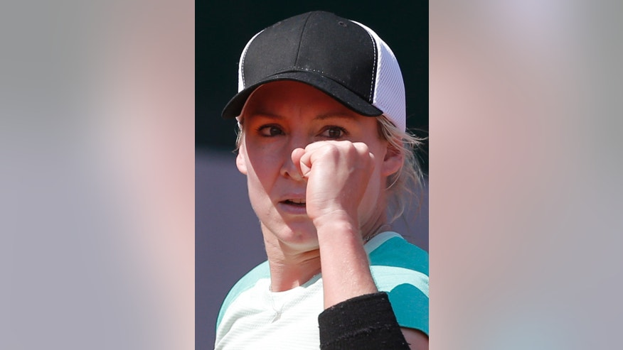 Bethanie Mattek-Sands of the U.S. clenches her fist after scoring against Spain's Lourdes Dominguez Lino in their first round match of the French Open tennis tournament, at Roland Garros stadium in Paris, Monday, May 27, 2013. (AP Photo/Michel Spingler)
