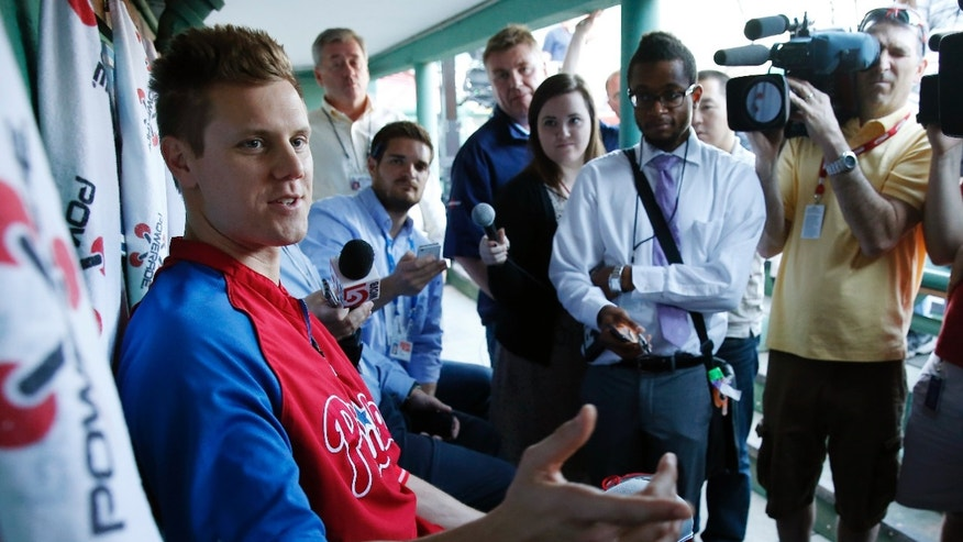 Philadelphia Phillies' Jonathan Papelbon talks with reporters before a baseball game against the Boston Red Sox in Boston, Monday, May 27, 2013. (AP Photo/Michael Dwyer)