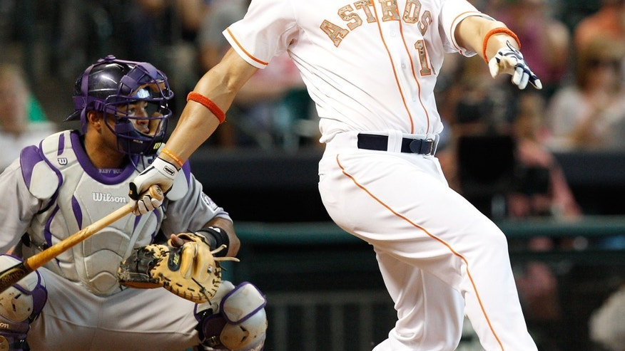 Houston Astros first baseman Carlos Pena (12) doubles to center field scoring two runs in the fourth inning against the Colorado Rockies during a baseball game, Monday, May 27, 2013, in Houston. (AP Photo/Bob Levey)