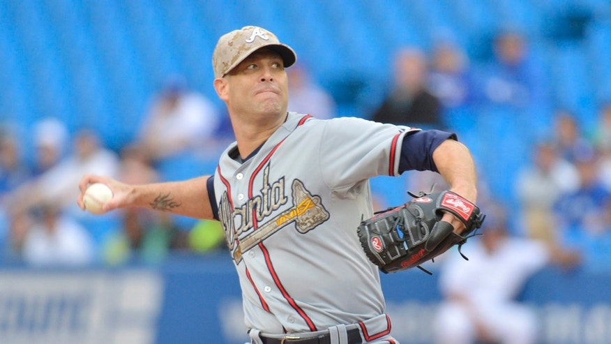 Atlanta Braves starting pitcher Tim Hudson pitches to the Toronto Blue Jays during first inning interleague baseball action in Toronto on Monday, May 27, 2013. (AP Photo/The Canadian Press, Nathan Denette)