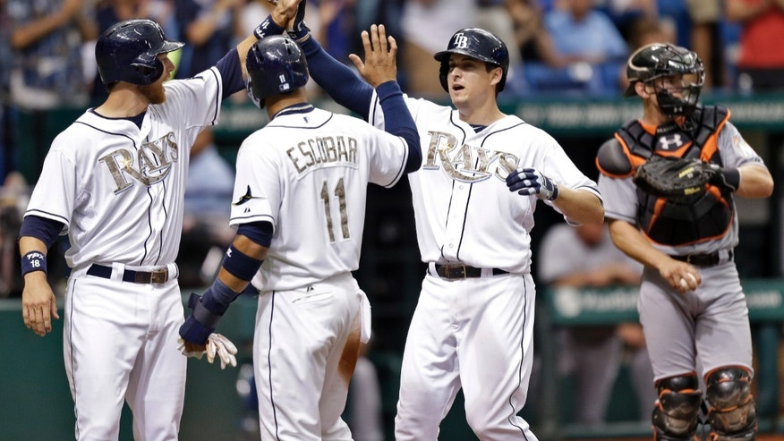 Tampa Bay Rays' Kelly Johnson, second from right, high fives teammates Ben Zobrist, let, and Yunel Escobar, second from left, after hitting a second-inning, three run home run off Miami Marlins starting pitcher Jose Fernandez during an interleague baseball game Monday, May 27, 2013, in St. Petersburg, Fla. Catching for the Marlins is Rob Brantly. (AP Photo/Chris O'Meara)
