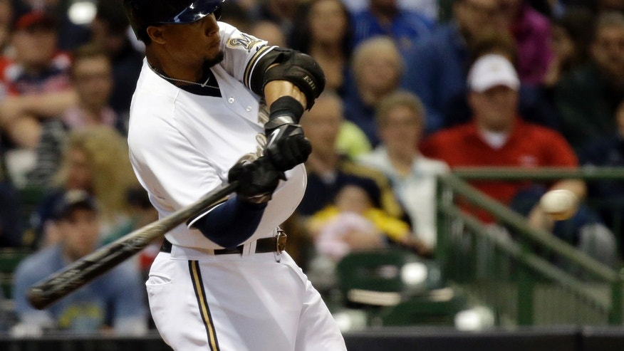 Milwaukee Brewers' Carlos Gomez hits a home run during the sixth inning of a baseball game against the Minnesota Twins Monday, May 27, 2013, in Milwaukee. The home run was his second of the game. (AP Photo/Morry Gash)