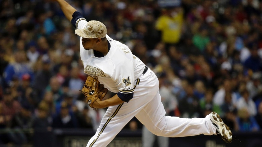 Milwaukee Brewers starting pitcher Wily Peralta throws during the first inning of a baseball game against the Minnesota Twins Monday, May 27, 2013, in Milwaukee. (AP Photo/Morry Gash)