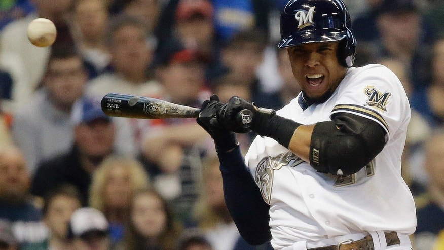 Milwaukee Brewers' Carlos Gomez is hit by a pitch during the first inning of a baseball game against the Minnesota Twins Monday, May 27, 2013, in Milwaukee. (AP Photo/Morry Gash)