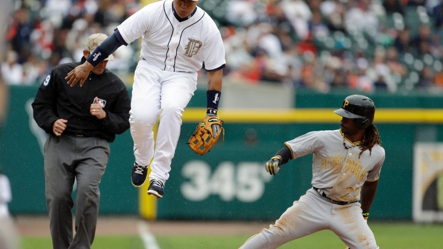 Pittsburgh Pirates center fielder Andrew McCutchen steals third under the leaping Detroit Tigers third baseman Miguel Cabrera during the sixth inning of a baseball game in Detroit, Monday, May 27, 2013. (AP Photo/Carlos Osorio)