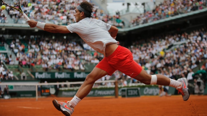 Spain's Rafael Nadal returns against Germany's Daniel Brands in their first round match of the French Open tennis tournament, at Roland Garros stadium in Paris, Monday, May 27, 2013. (AP Photo/Christophe Ena)