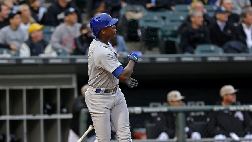 Chicago Cubs' Alfonso Soriano thinks he hit a home run but bounced off the wall for an RBI single in the first inning against the Chicago White Sox in a baseball game in Chicago on Monday, May 27, 2013. (AP Photo/Charles Cherney)