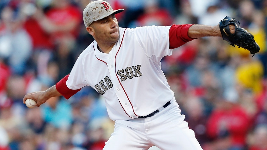Boston Red Sox's Alfredo Aceves pitches in the first inning of a baseball game against the Philadelphia Phillies in Boston, Monday, May 27, 2013. (AP Photo/Michael Dwyer)