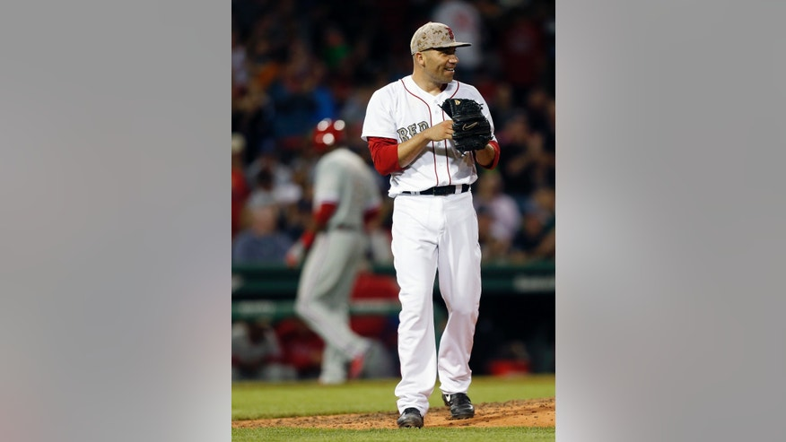 Boston Red Sox's Alfredo Aceves looks to the outfield after teammate Jacoby Ellsbury made the catch on a fly ball by Philadelphia Phillies' Freddy Galvis to retire the side with men on base in the sixth inning of a baseball game in Boston, Monday, May 27, 2013. (AP Photo/Michael Dwyer)