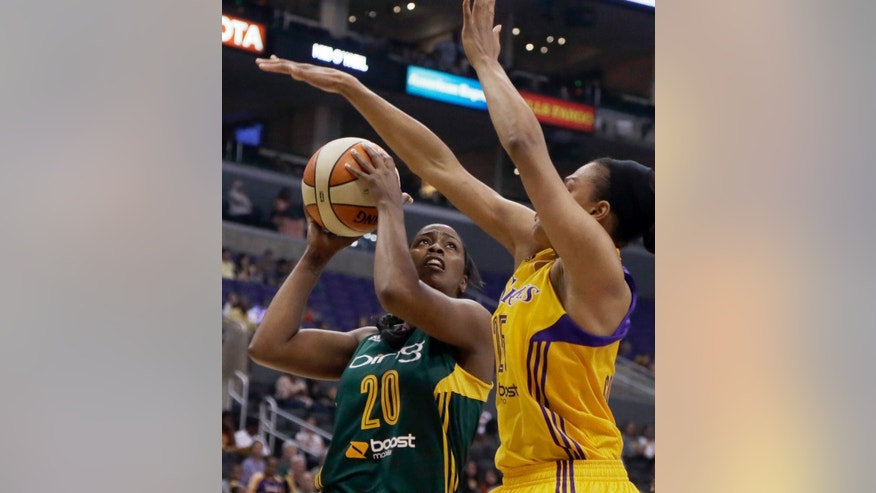 Seattle Storm forward Camille Little (20) shoots as Los Angeles Sparks' Marissa Coleman defends in the first half of a WNBA basketball game in Los Angeles Sunday, May 26, 2013. (AP Photo/Reed Saxon)