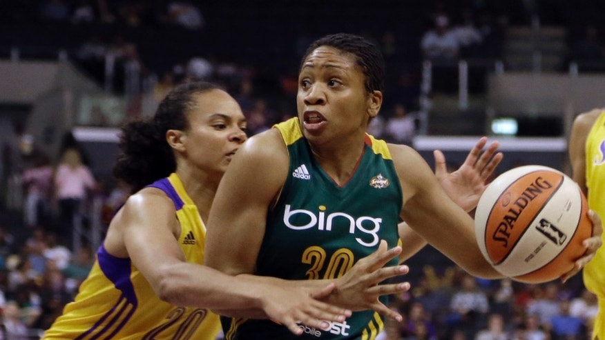 Seattle Storm guard Tanisha Wright (30) drives as Los Angeles Sparks guard Kristi Toliver (20) defends in the first half of a WNBA basketball game in Los Angeles Sunday, May 26, 2013. (AP Photo/Reed Saxon)