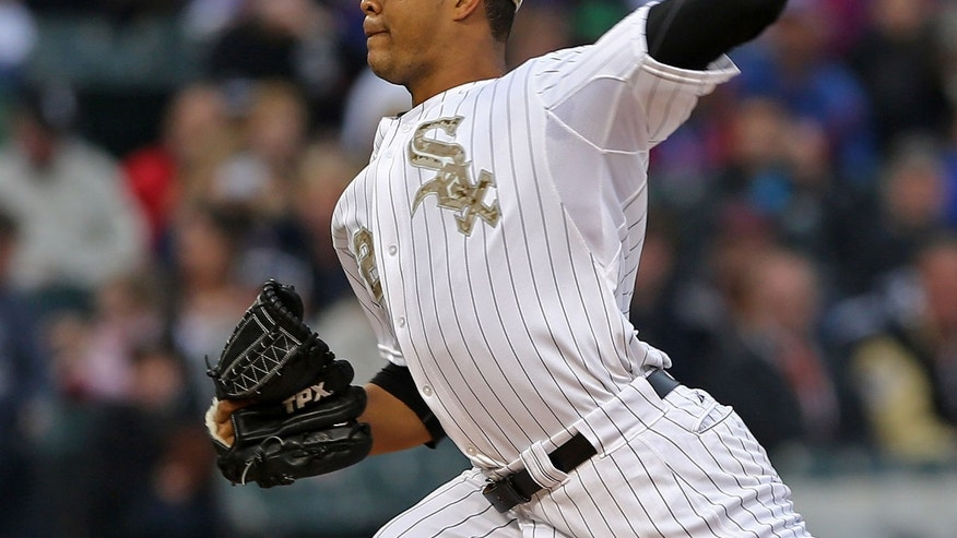 Chicago White Sox starting pitcher Jose Quintana pitches to the Chicago Cubs in the first inning in a baseball game in Chicago on Monday, May 27, 2013. (AP Photo/Charles Cherney)