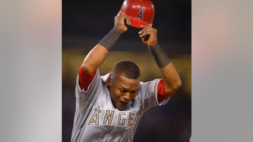 Los Angeles Angels' Erick Aybar throws his helmet after he was forced out at first for a double play on a fly ball by Mike Trout during the eighth inning of a baseball game against the Los Angeles Dodgers, Monday, May 27, 2013, in Los Angeles. The Dodgers won 8-7. (AP Photo/Mark J. Terrill)