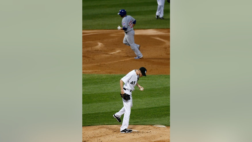 Chicago White Sox starting pitcher Chris Sale returns to the mound after giving up a two-run home run to Chicago Cubs' Welington Castillo, top, during the second inning of an interleague baseball game Tuesday, May 28, 2013, in Chicago. (AP Photo/Charles Rex Arbogast)