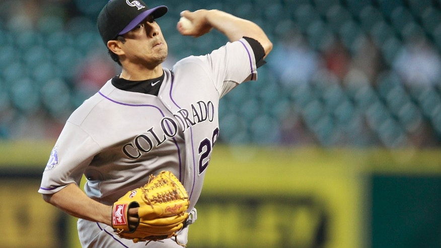 Colorado Rockies pitcher Jorge De La Rosa (29) throws in the second inning during a baseball game against the Houston Astros, Tuesday, May 28, 2013, in Houston. (AP Photo/Patric Schneider)