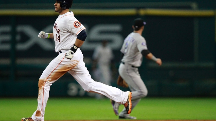 Houston Astros' J.D. Martinez (14) heads to second after hitting a double in the fourth inning against the Colorado Rockies during a baseball game, Tuesday, May 28, 2013, in Houston. (AP Photo/Patric Schneider)
